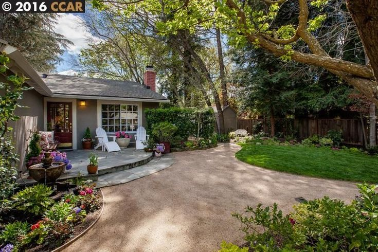 Traditional Landscape/Yard with Pathway, Fence, Fountain, exterior stone floors