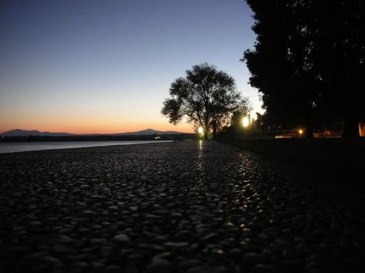 Walking on sunset of Trasimeno lake