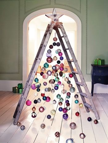 Hang baubles for a waterfall effect from a ladder - obviously treat the ladder to make it look nicer