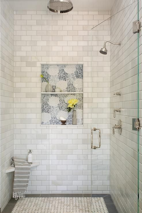 White Marble Subway Tiles Surround A Shower Niche Accented