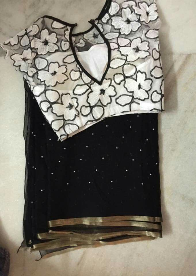 Black saree with white blouse such a lovely elegant combination.