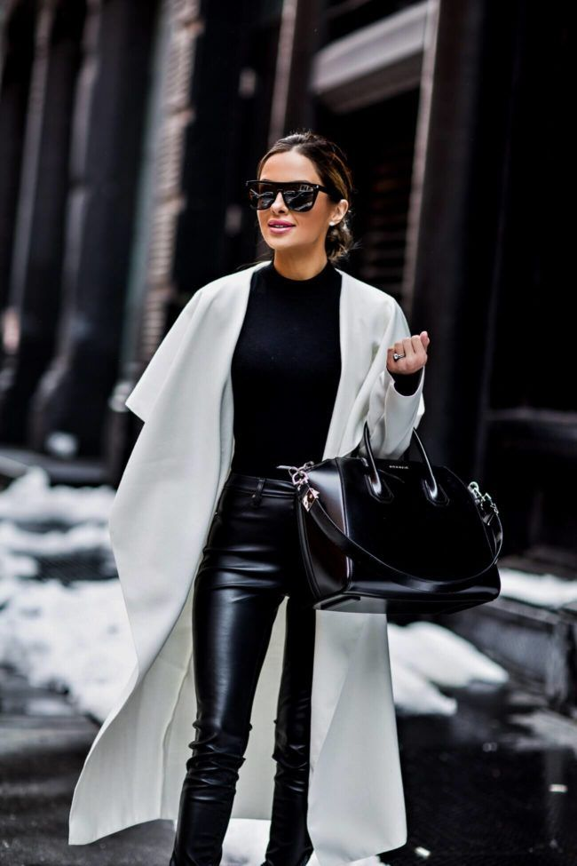 fashion blogger mia mia mine wearing a white trench coat and black bodysuit at new york fashion week February 2017