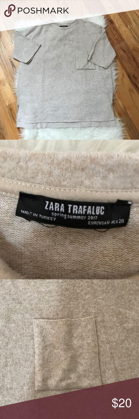 Zara Spring/Summer 2017 top This is a warm Zara short sleeve top. Feels like a brushed, soft material.  Sleeves have a natural cut look as does the bottom. Back is slightly longer than the front. EUC with no signs of wear. Measurements are approximate: armpit to armpit 23 1/2, length:  front 24 inches, back 25 inches.  Great for the fall or under a cardi in the winter. Neutral tan color. Zara Tops Tees - Short Sleeve