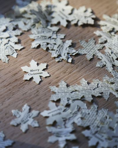 table confetti mini snowflakes cut from book pages