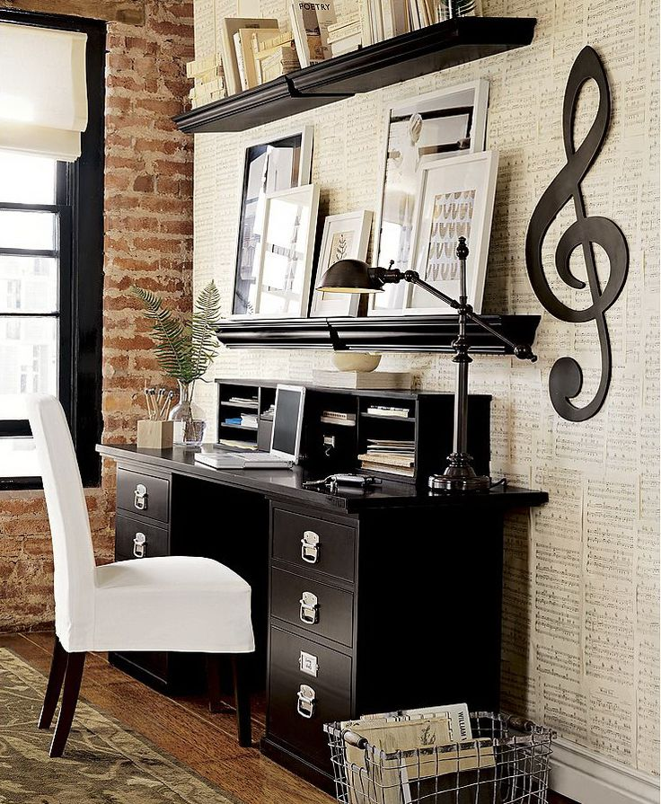 Sheet music covering the wall with a large treble clef... musician's office?