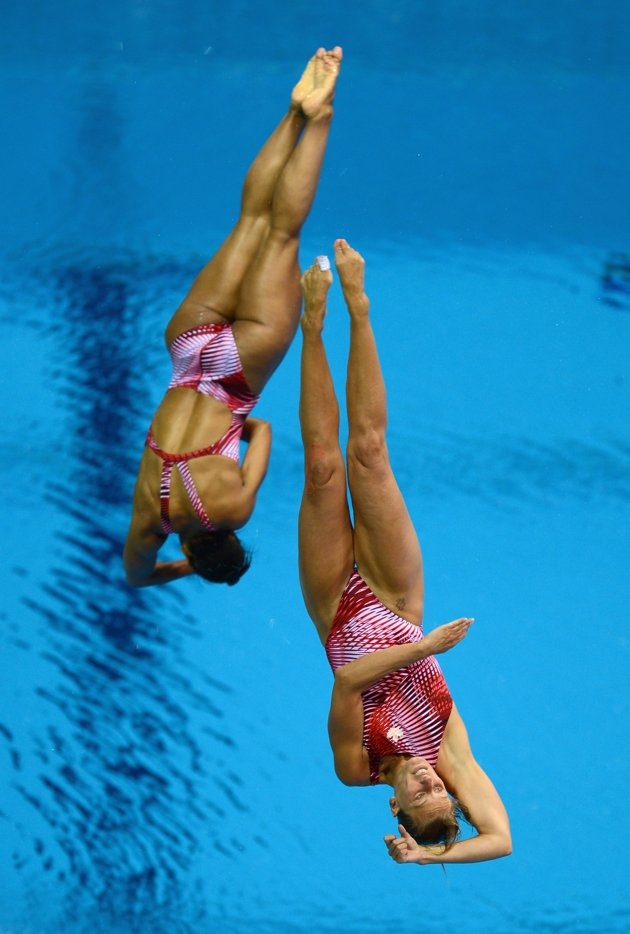 Olympics: Day Two - JULY 29: Emilie Heymans and Jennifer Abel of Canada dive during the Women's Synchronized 3m Springboard Final at the London 2012 Olympic Games on July 29, 2012 in London, England. (Photo by Julia Vynokurova/Getty Images)