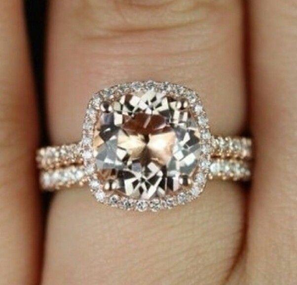 Round Morganite center stone in diamond cushion cut halo with diamond shank set in rose gold with rose gold and diamond matching band. Love.