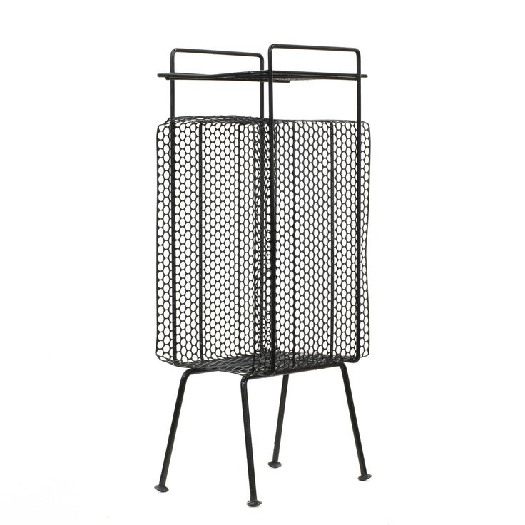 This mid century modern magazine rack is featured in a wire metal with a black paint finish. This magazine stand has slanted legs, circle mesh sides and a top shelf tier. Stylish table perfect for storing records! #midcenturymodern #storage #magazinerack #sandiegovintage #vintagefurniture