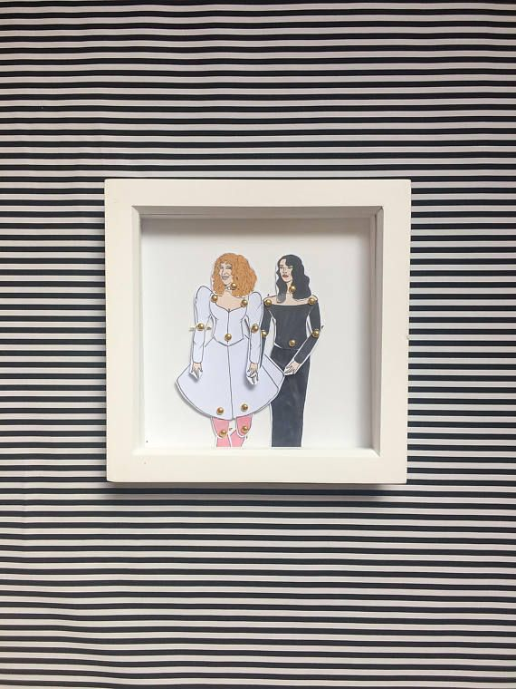 Bette Midler and Barbra Hershey Beaches framed dolls! These beautiful little dolls are hand illustrated by myself, hand cut and pinned using mini gold brad pins then framed.  The frames come in a lovely little package that can be personalized all you have to do is message me with who the gift is TO: and FROM: and I can pop that on ready for gifting.  All dolls are roughly 25cm tall and are professionally printed on sturdy 300gsm matt card before being hand cut and pinned. All framed doll…