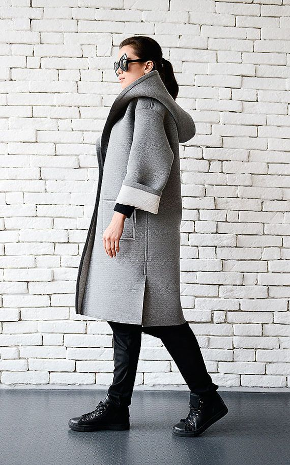 Oversize grey long coat - METC0043  A very comfortable piece that is a great addition for your winter collection. The coat has a beautiful light grey color and a structure that suits everyone. There is big hood that is both beautiful and practical as well as side pockets. Wear the sleeve free or folded for a different look.  The coat is made of neoprene.  CUSTOMIZED: This coat could be made in different colors. Please, contact me for more information!  The item from the picture is size S…