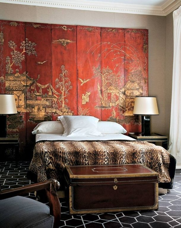 folding screen as backdrop for bed with animal print cover