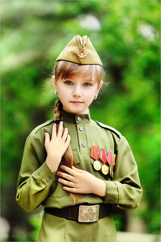 A Russian girl dressed in a World War II Red Army uniform to celebrate Victory Day in Volgograd, the wartime Stalingrad (May 9, 2014).
