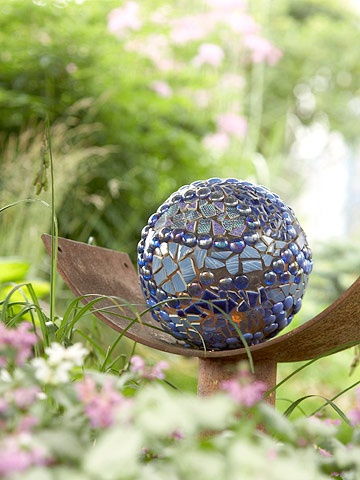 Employ Garden Art:   Create surprises and add interest to your plants with little touches of art. This bowling ball, for example, instantly became an eye-catching mosaic sculpture with the addition of some beads and broken glass.