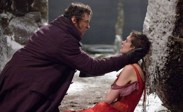 "MOVIE REVIEW  The Wretched Lift Their Voices  'Les Misérables' Stars Anne Hathaway and Hugh Jackman       Laurie Sparham/Universal Pictures  Hugh Jackman and Anne Hathaway in  ""Les Misérables.""  By MANOHLA DARGIS  Published: December 24, 2012"