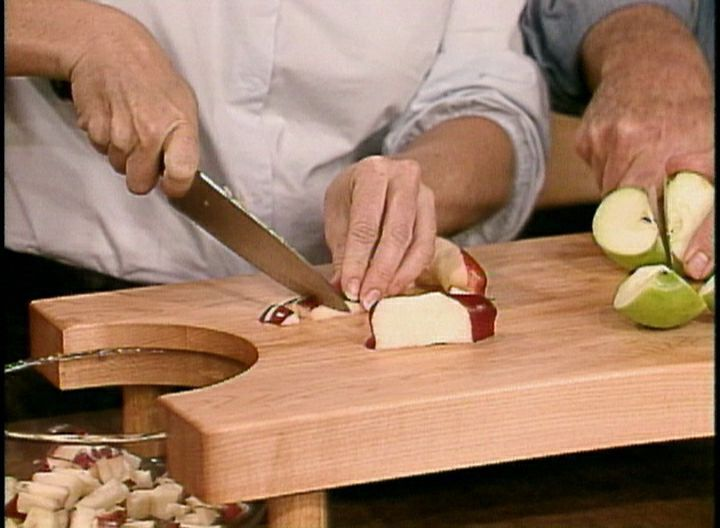 Learn how to make a butcher block chopping board with a notch for scraping food into a bowl.