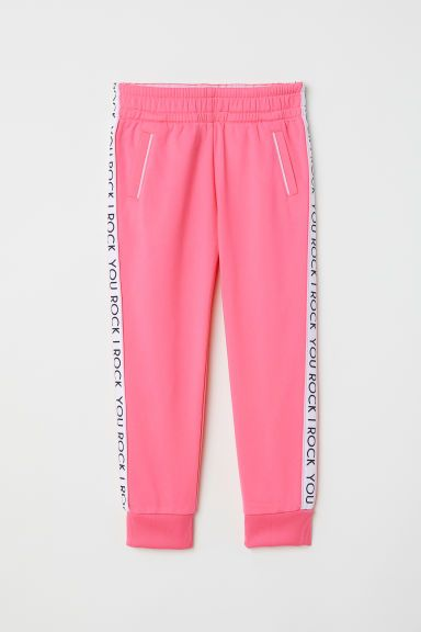 Sports trousers - Neon pink/You Rock - Kids | H&M GB
