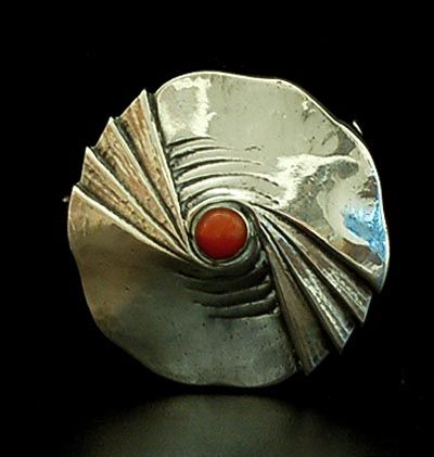 Silver hammered Amsterdamse School brooch with round cabuchon cut red coral design Fons Reggers executed by Gebr.Reggers Amsterdam / the Netherlands 1923-1934