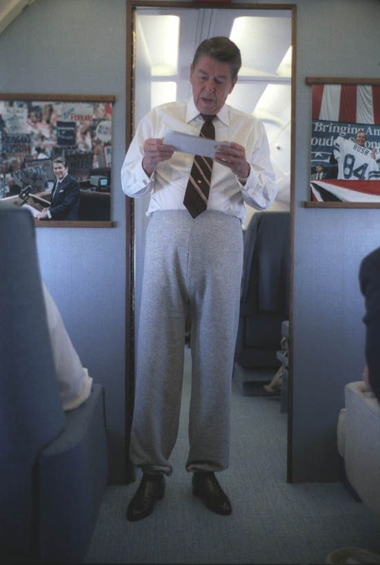 Ronald Reagan rocking sweat pants and a tie on Air Force One. TFM.