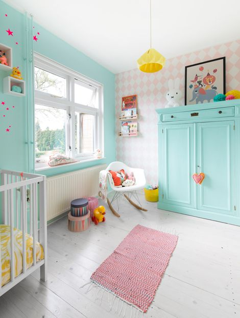 Beautiful soft pallets if coral and turquoise for a contemporary childrens bedroom or nursery