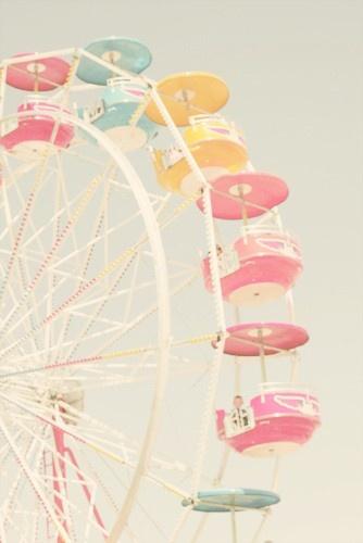 Summer fair ground rides in pretty pastels
