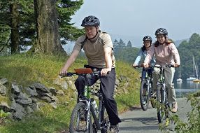 Cycling along Windermere Lake shore.