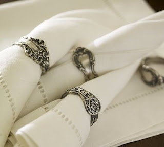 Victorian Napkin Rings - You can buy these at Pottery Barn or you could go to the thrift store and try to make these yourself. Cheap silverware is pretty easy to bend.