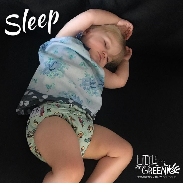 #clothshotaday2017 - Day 13: Sleep  . Sleep is no problem when you've got great nappies for slee time like our versatile Grovia O.N.E nappies and our ultimate heavy wetter RAWR Stuff n Snap night nappies  . . . . [image of a white female toddler with blonde hair wearing a pastel green cloth nappy with a car pattern and a blue dress. She is lying at an angle on her back asleep on a black couch and with her arms above her head.]