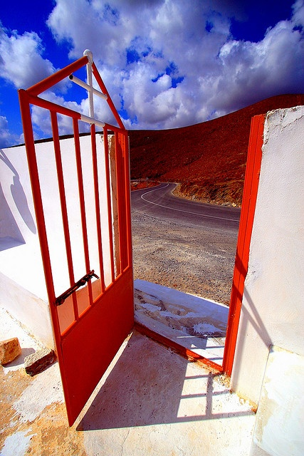 Red iron gate and dramatic sky in Astypalea island #travel #holidays #visitGreece