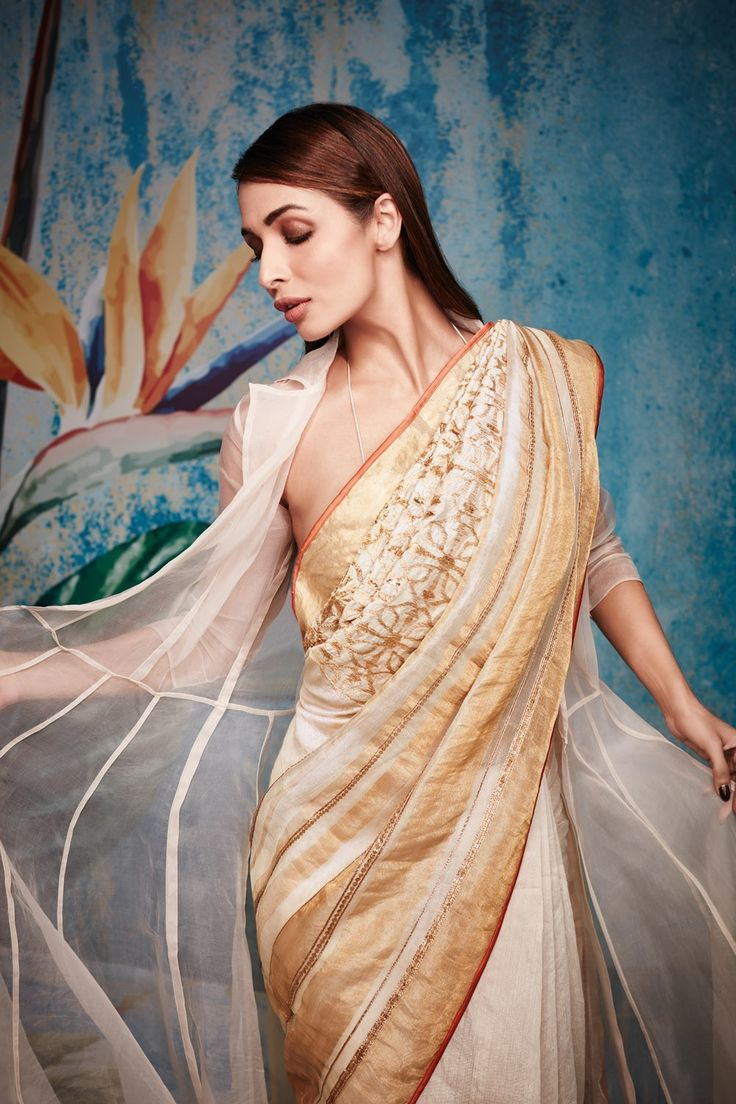 A perfect mixture of geometric forms with ombre in colourful hues make his embroidered saree collections a first choice for cocktails. Bollywood beauties like Malaika Arora Khan, Aishwarya Rai Bachan as also television anchors like Mandira Bedi love flaunting these sarees at every public appearance. sarees, designer sarees, best offers on designer sarees, deals on designer sarees, tikli.in sarees, tikli.in exclusive. tikli.in, amazing collections of satya paul, satya paul collections,