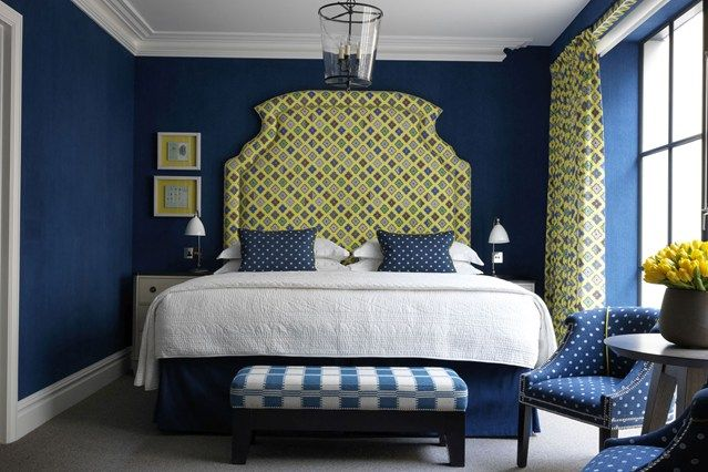 Kit Kemp's Ham Yard Hotel in London with a blue and lime bedroom colour scheme
