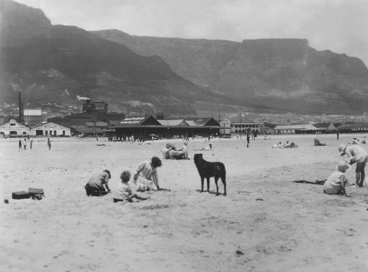 Woodstock beach, Cape Town c.1930's. see the old Castle brewery?