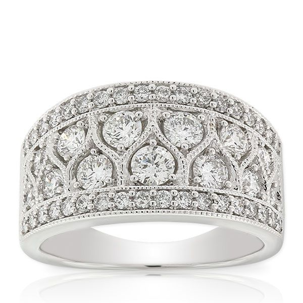 Wide tapered diamond band with 1 and 3/8 carat total weight and milgrain detailing in 14K white gold.