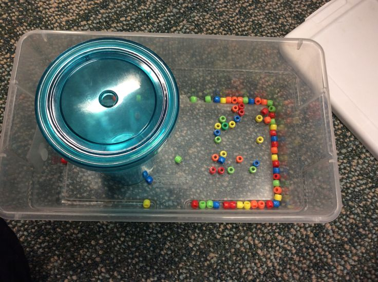 Put In Task- Put the beads inside the hole on the cup where the straw is meant to go!!