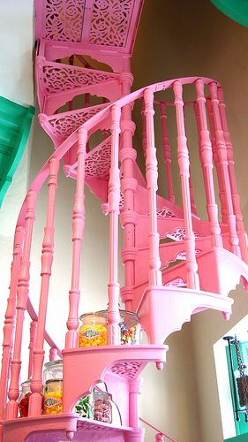 Pink cast iron circular stairs--okay,maybe I wouldn't want pink...but dark green? Dark purple? then again, why not pink!