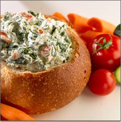 Best Spinach Dip ever - 1 (10 ounce) package frozen chopped spinach, thawed and squeezed dry;  1 (16 ounce) container sour cream;  1 (8 ounce) package vegetable soup mix;  1 (8 ounce) can water chestnuts, drained and chopped;  serve with Hawaiian Bread or use as a veggie dip! YUM!!