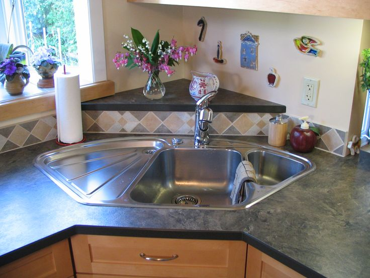 Blanco corner sink with raised back triangle laminate for Corner sink kitchen design ideas