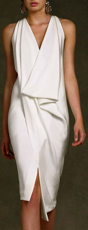 Donna Karan love this but prefer a sleeve added for my upper arms to mid forearm length