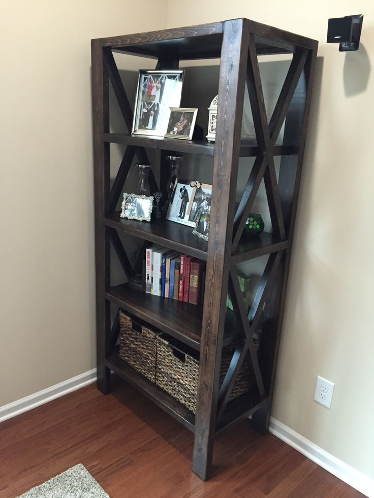 Rustic X bookshelf built from Ana White plans. Assembled using Kreg Pocket Screw Jig. Stained using Rustoleum Ultimate Kona Stain and protected with 3 coats of Rustoleum Ultimate Satin Polyurethane.