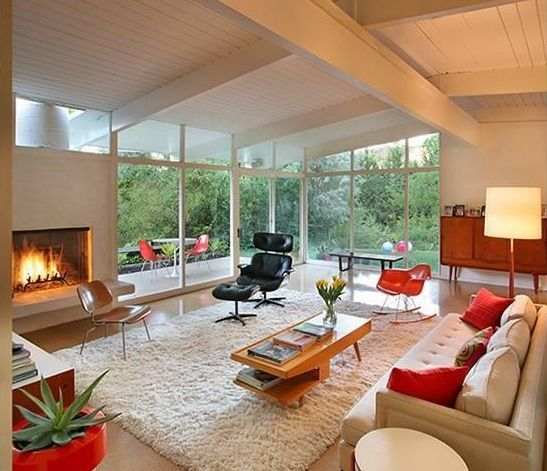 Mid-century modern living room. 1950s rancher style bungalow. Open, airy and wonderfully furnished.