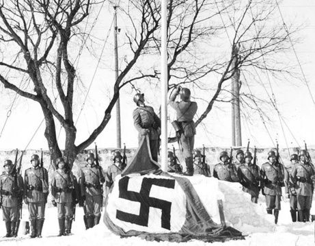 This chilling photograph of the national flag being replaced with the swastika might have been taken in almost any European city. But it was actually a staged photo, taken at Lower Fort Garry in Winnipeg, Manitoba  on IF Day, Feb. 19, 1942, part of a staged Nazi invasion.