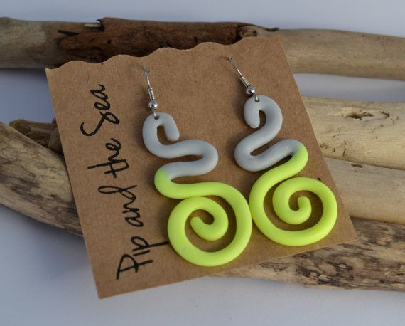 Curly earrings in grey and fluorescent yellow on allergy-friendly surgical steel hooks.