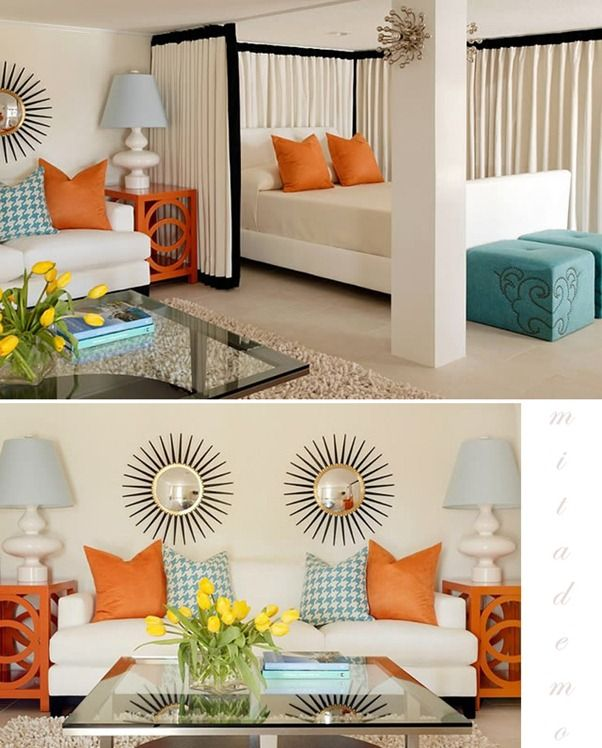 Love the curtain around the bed! white, blue, orange bedroom
