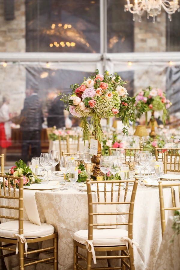 Lush tall wedding centerpieces with gold chiavari chairs for a tented wedding reception (Pepper Nix Photography)