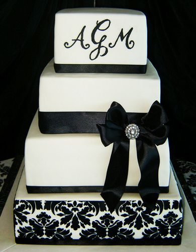 black and white damask - Piping done with royal icing.  Damask is with stencil. Ribbon is satin.