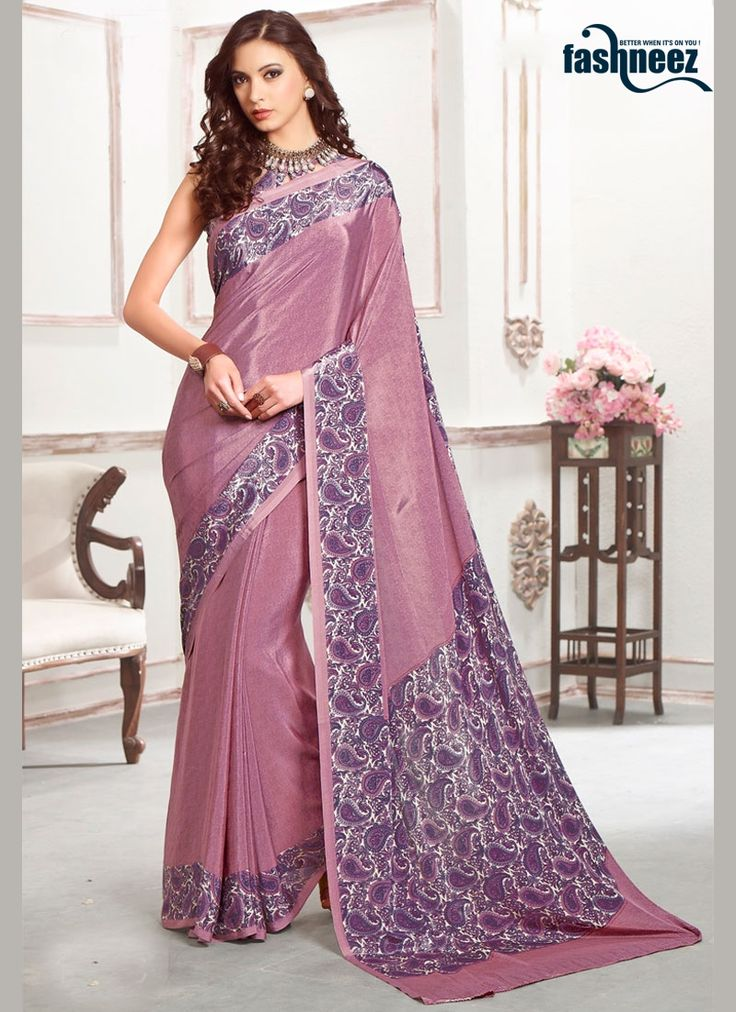 Make the heads turn whenever you costume up in this pretty purple faux crepe casual saree. The amazing attire creates a dramatic canvas with amazing print work. Comes with matching blouse. (Slight var...