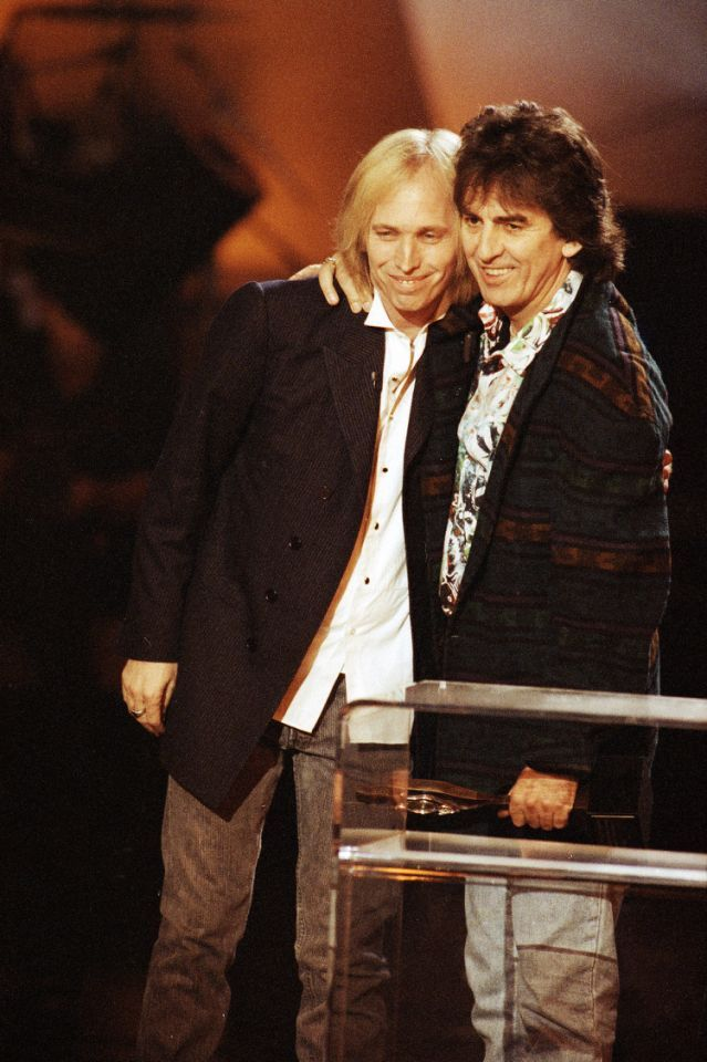 Tom Petty and fellow Traveling Wilbury George Harrison are captured together at the Billboard Music Awards in Los Angeles, on Dec. 9, 1992.