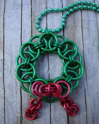 Chainmaille Wreath made from the Helm weave pattern and an original 3D bow. Get your kit for this original pattern from Crafty Cat Jump Rings.