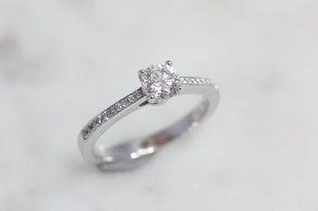 Bilkey & Co. delicate diamond solitaire.