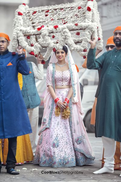 Bridal Lehengas - Bride in a Light Pink Wedding Lehenga with Grey Embroidery | WedMeGood #wedmegood #indianbride #indianwedding #pink #grey #bridalentry #phoolonkichaadar for custom or replica bridal and party wears email zifaafstudio@gmail.com visit us at www.zifaaf.com