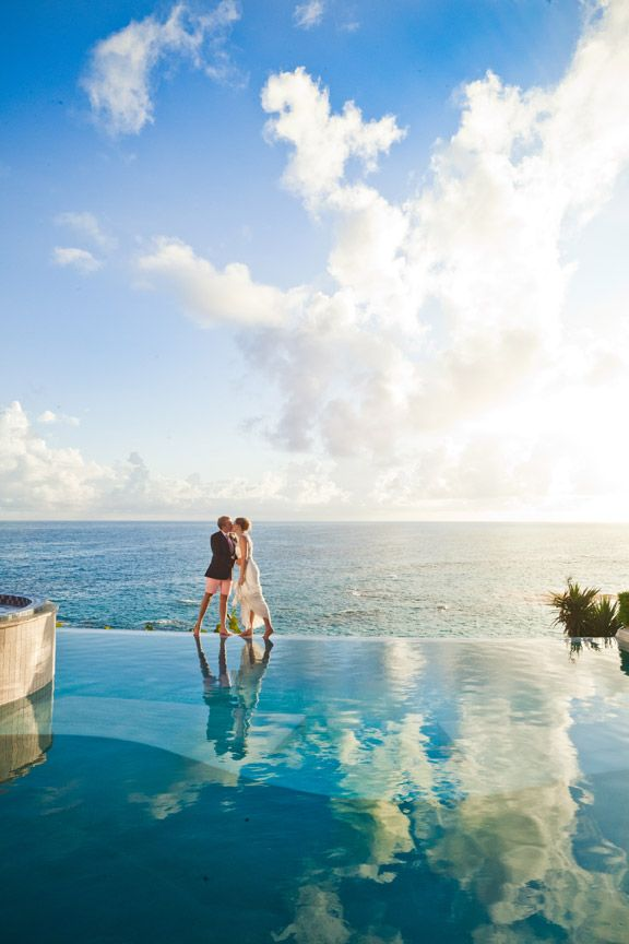 Where else could get a kiss at the edge of the earth? The Reefs, Bermuda #BeachWedding